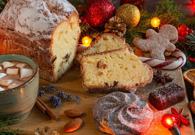 Christmas and new year compositions on a brown background christmas cake gingerbread copy space flat...