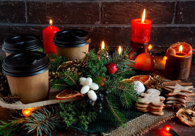 Christmas and new year compositions on a brown background cones spruce gingerbread copy space flat l...