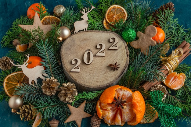 Christmas and new year compositions on a on a green background  copy space flat lay