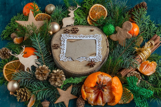 Christmas and new year compositions on a on a green background tangerines oranges gingerbread copy s...