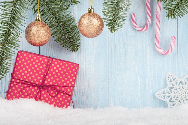 Christmas and new year concept background with gift box, christmas balls and candy canes