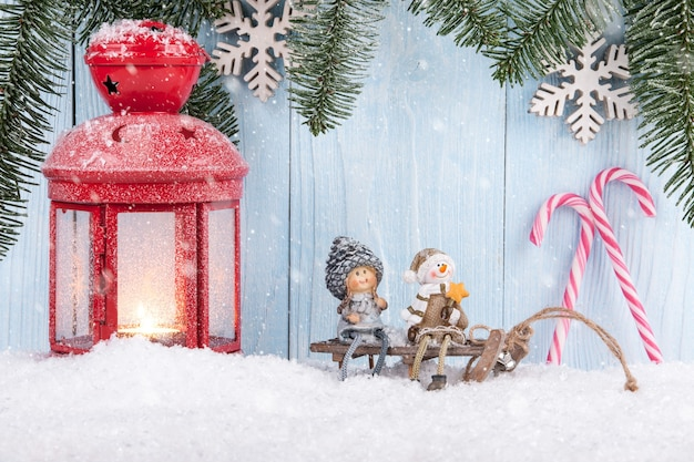 Christmas and new year concept background with smiling figurines, christmas lantern and candy canes