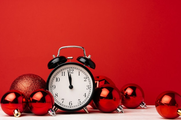 Christmas and new year countdown concept with alarm clock