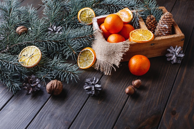 Christmas and new year decor. oranges, cones and christmas tree branches