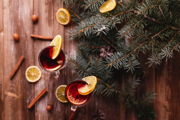 Christmas and new year decor. two cups of mulled wine with oranges
