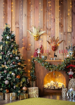 Christmas and new year decorated the interior wooden room with gifts and a christmas tree