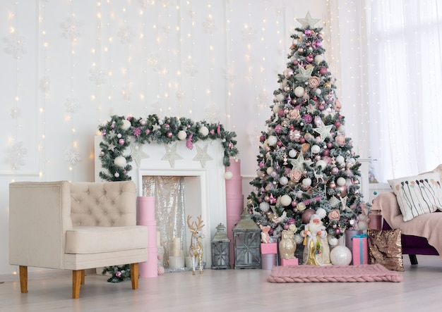 Christmas and new year decorated pink interior room with presents