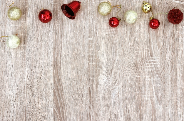 Christmas new year decoration bell and gifts with copy space on wooden background