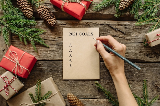 Christmas or new year decorations and notebook with 2021 goals.