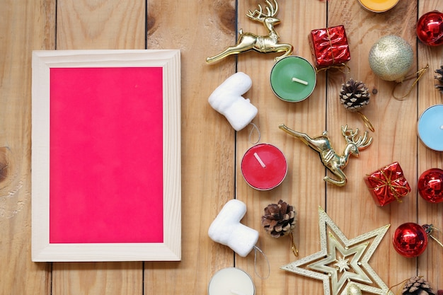 Christmas and new year decorations picture frame on wooden floor and have copy space for design in your work.