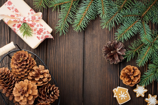 Christmas or new year. fir-tree branches , christmas tree toys, stars, snowflake and cones on dark brown wooden.