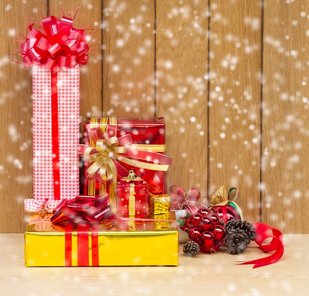 Christmas and new year gifts on wooden boards
