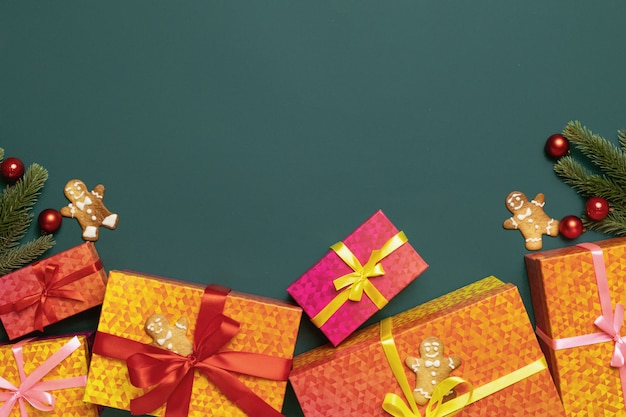 Christmas and new year green background with colorful gifts christmas decorations