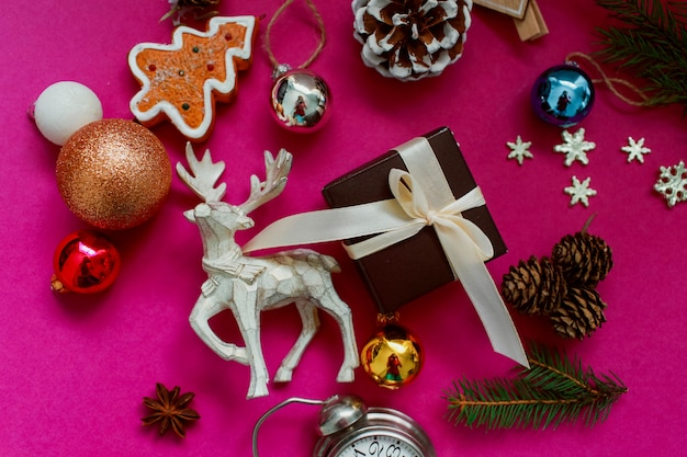 Christmas and new year holiday background and wallpaper. christmas festive decoration toys on a pink background