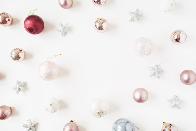 Christmas new year holiday composition. frame of neutral christmas baubles balls and stars on white