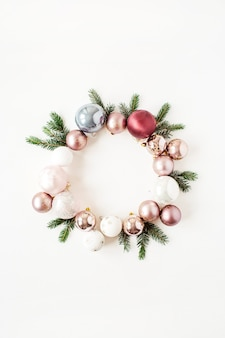 Christmas new year holiday composition. frame wreath with mock up copy space of christmas baubles balls and fir branches on white
