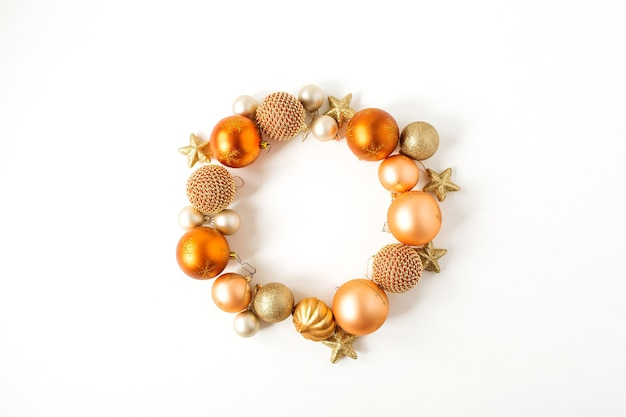 Christmas new year holiday composition. frame wreath with mock up copy space of ginger christmas baubles, balls and stars on white