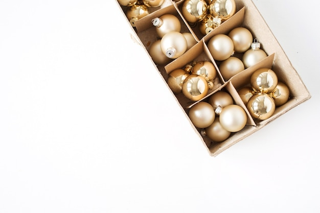 Christmas new year holiday composition. gold christmas baubles balls on white