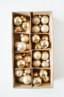Christmas new year holiday composition. golden christmas baubles balls on white