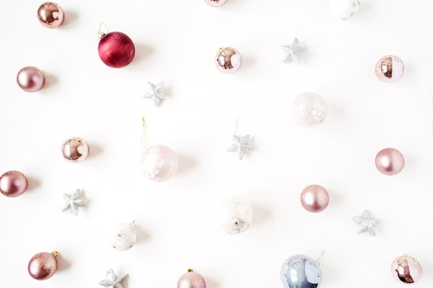 Christmas new year holiday composition. neutral christmas baubles balls and stars on white