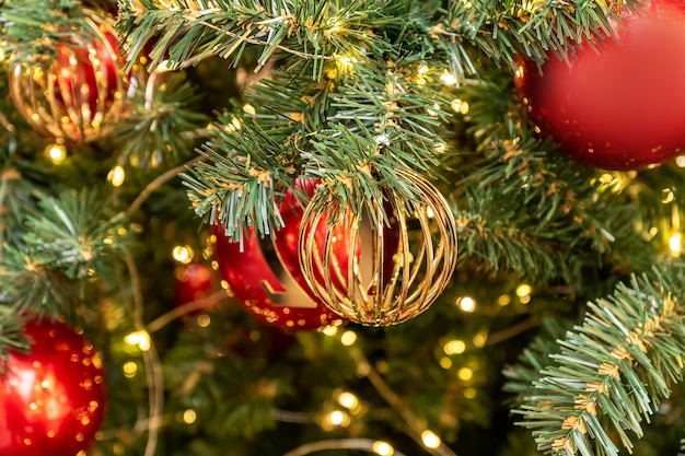 Christmas and new year holidays background christmas tree decorated with golden and red balls celebr...