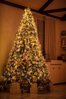 Christmas and new year's elegant decor tree with gifts
