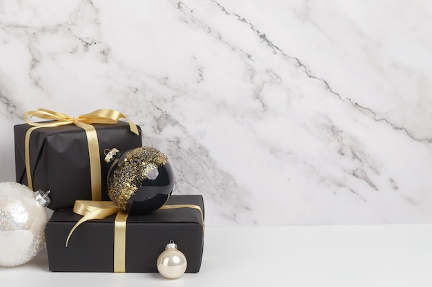 Christmas new year's eve composition. boxes of gifts and christmas decorations on a white marble background