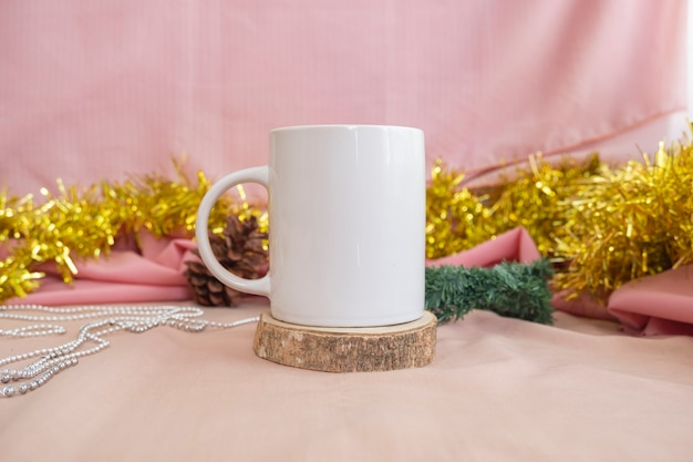Christmas and new year's minimalist concept. composition featuring product mug. mug on wood with christmas and new year decorations