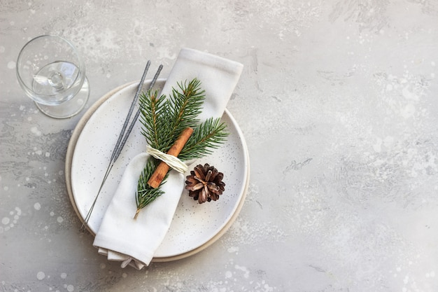 Christmas or new year table setting with festive decorations.