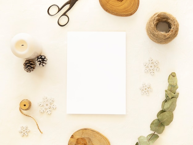 Christmas or new year white mockup copy space on a paper sheet with christmas decorations twine