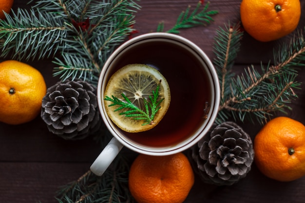 Christmas new year with tangerines, tea with lemon. winter still. selective focus.