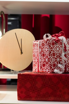 Christmas new year wrapped gifts with ribbons. almost midnight on the clock