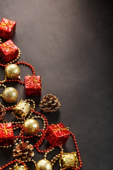 Christmas or new years dark background with red and gold decorations for the christmas tree with free space. view from above. christmas mood.