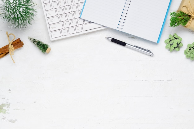 Christmas and new years office work space desktop flat lay, white background