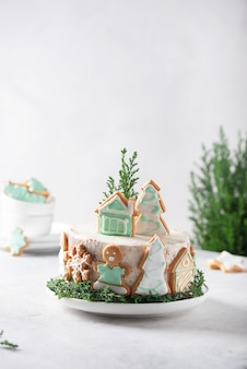 Christmas nude cake with white cream and christmas decoration, selective focus image