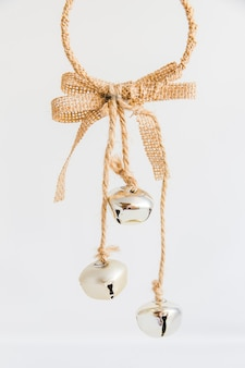 Christmas ornament with silver jingle bells on white background