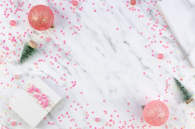 Christmas ornaments on marble surface