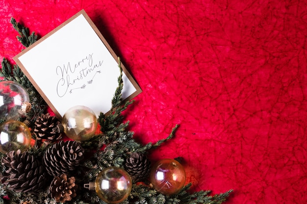 Christmas ornaments on red background with copy space