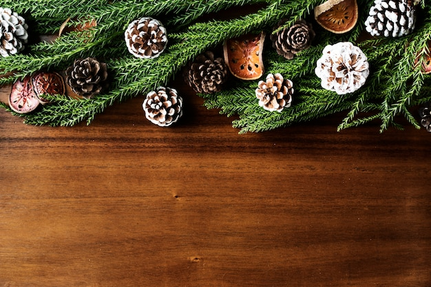 Christmas ornaments on wooden background with design space