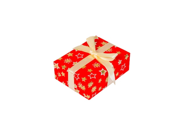 Christmas or other holiday handmade present in red paper with gold ribbon