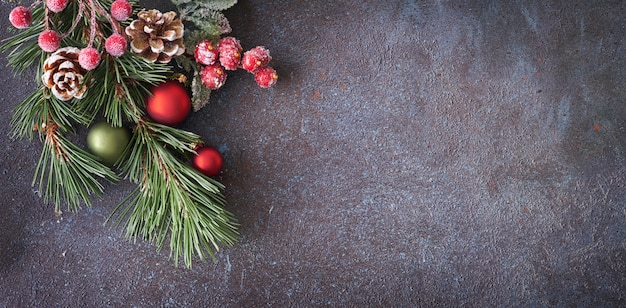Christmas panoramic background with pine twigs, cones and berries