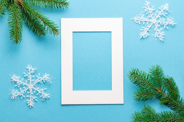 Christmas paper frame for a photo on blue backdrop