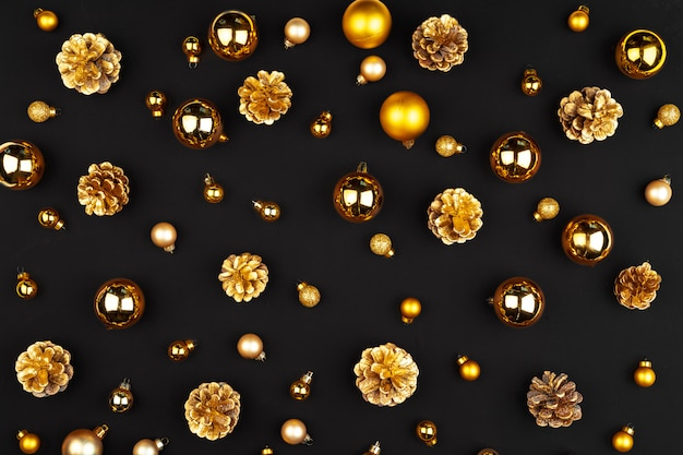 Christmas pattern of holiday decorations on dark background