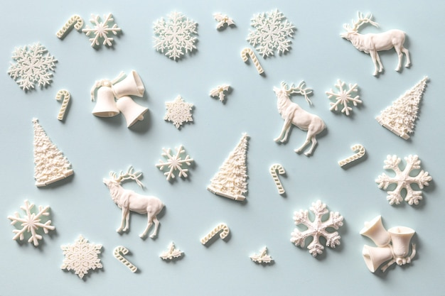 Christmas pattern of white holiday diy decoration on blue. holiday abstract background.