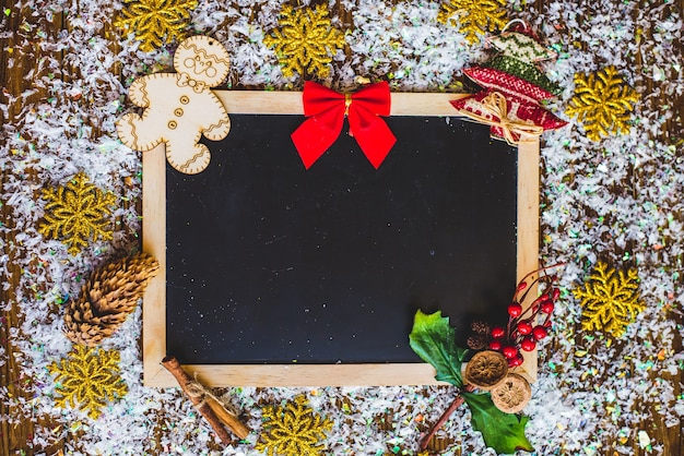 Christmas photo frame card, on a wooden background.
