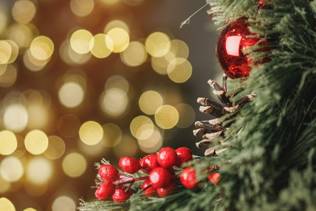 Christmas pine tree branch with decorations close up
