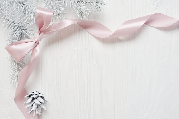 Christmas pink ribbon frame with tree cone, flatlay