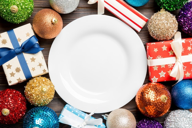Christmas plate on wooden  background with decorations
