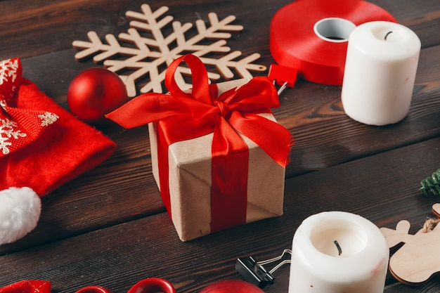Christmas preparations. wrapping gift with paper and ribbon