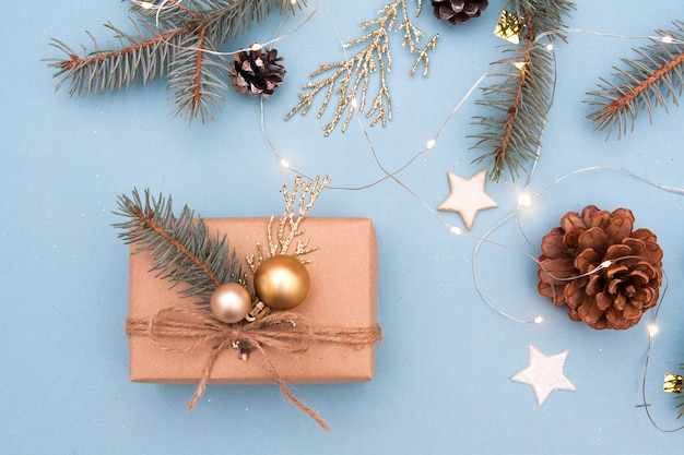 Christmas present with decor on a blue background. christmas gift, new year preparation concept